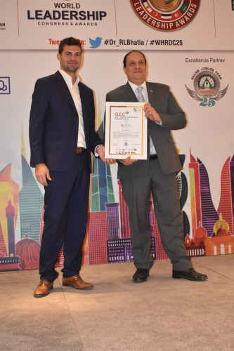 osama-mamdouh-receiving-gcc-best-employer-award-min.jpg