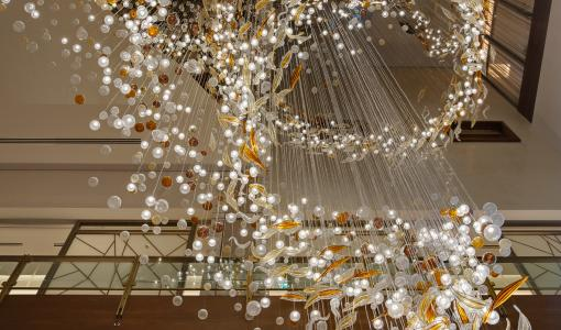 The movement of birds captured and translated into 3500 pieces of hand-blown glass installation: The Swoop