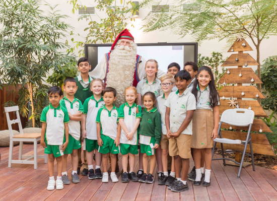 santa-claus-with-the-arbor-school-students.jpg